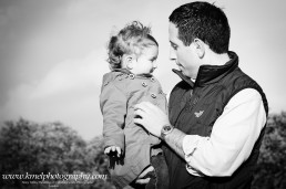 Black and white Father holding his child in his arms
