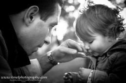 Tender moment between Father and daughter in playground