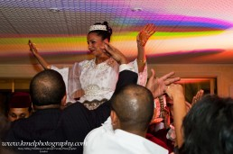 bride lifted in the air by wedding guests