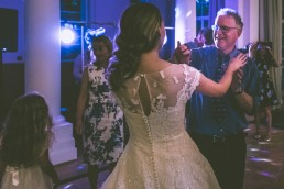 Father and married daughter dancing.